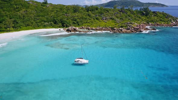 Thumbnail for Aerial View of Lonely Luxury Catamaran Yacht in Blue Lagoon. La Digue Island, Seychelles