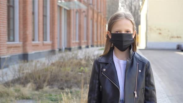 Thumbnail for Girl Wearing a Mask Protect Against Coronavirus and Gripp