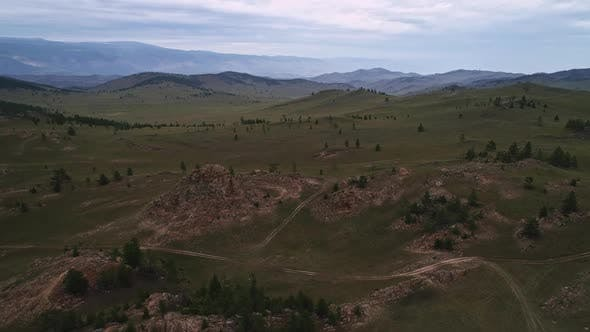 Baikal Valley spirits,Tazheran Steppe, Stone Cliffs on the Road, Aerial Summer