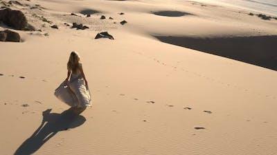 Drone Of Woman Walking On Sandy Beach