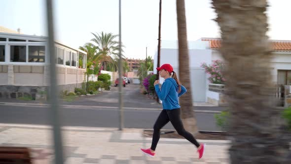 Thumbnail for Woman Runs Down the Street. Healthy Active Lifestyle. Side View