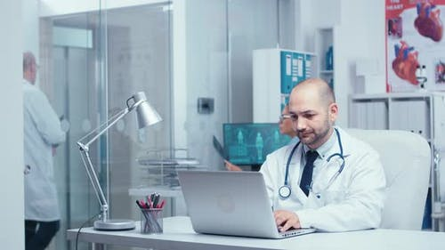 Doctor Typing an E-mail
