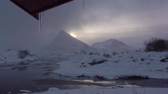 Thumbnail for Snowfall in the Mountains at Sunset