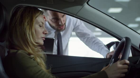 Thumbnail for Auto Salesman Talking to Client Sitting in Car