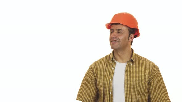 Thumbnail for Cheerful Mature Builser in Hardhat Posing with a Drill Machine