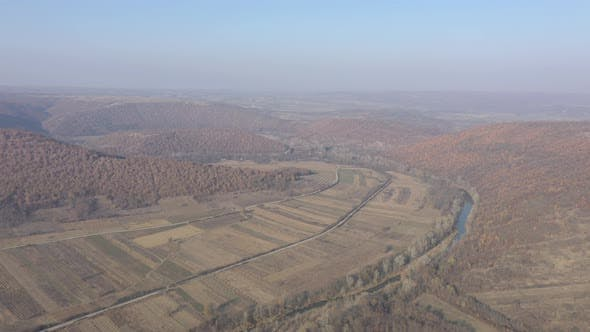 Thumbnail for Aerial of Serbian landscape with fields and nature by autumn 4K drone footage