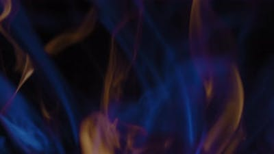 Blue and yellow flames moving slowly