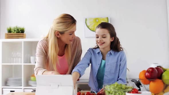 Thumbnail for Family Cooking Dinner Using Tablet Pc at Kitchen