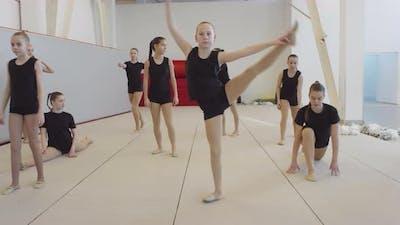 Girls Warming Up during Cheerleading Practice