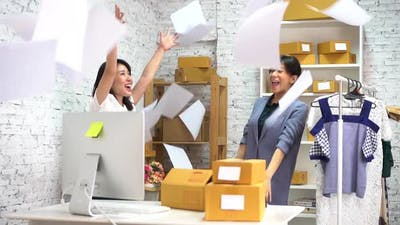 Happy Young Women Throwing Paper Document Pages