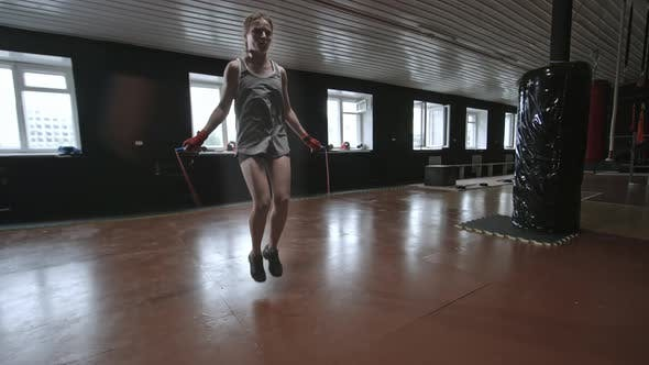 Thumbnail for Athletic Young Woman Jumping with Rope