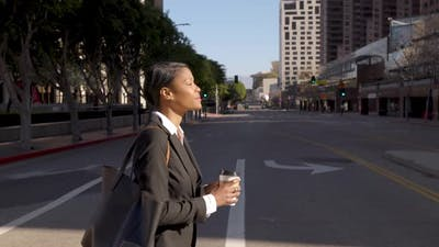 Mixed ethnicity business woman walking