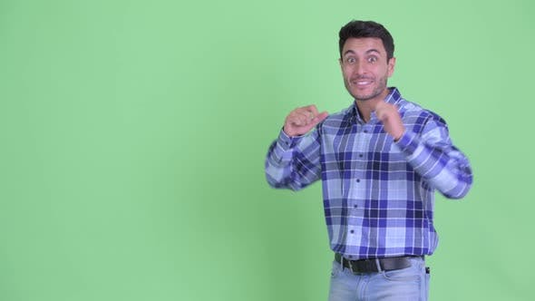 Thumbnail for Happy Young Hispanic Man Presenting Something and Looking Excited