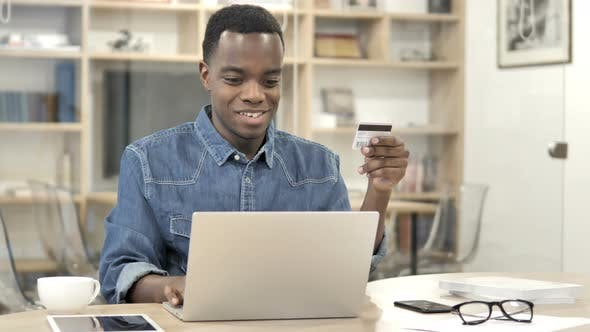 Cover Image for Online Shopping with Credit Card by Afro-American Designer