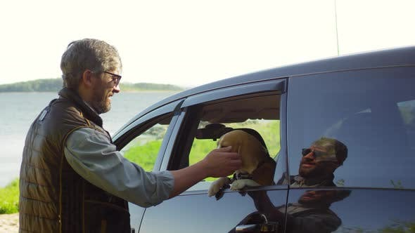 Thumbnail for Man Petting Cute Dog and Sitting in Car for Ride
