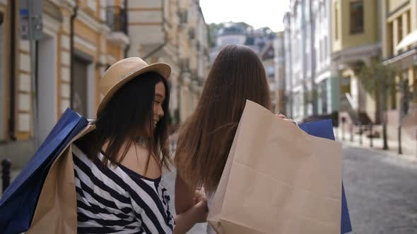 Thumbnail for Asian and Caucasian Shopper Friends Smiling at Cam