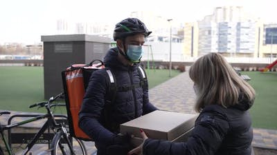 Food Courier Delivering Pizza to Customer By Bike