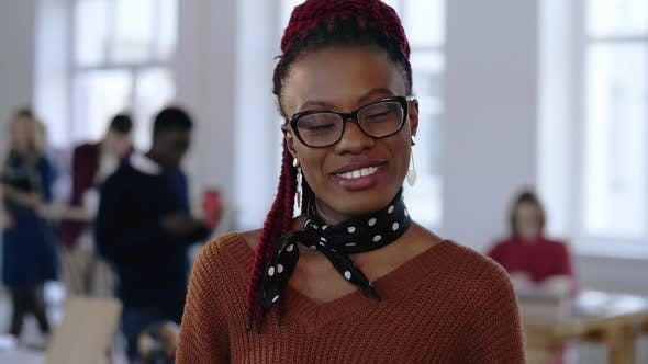 Young Happy African Creative Designer, Professional Successful Business Woman in Eyeglasses