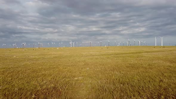 Bird'seye View of Wind Turbines Generating Green Electricity in a Steppe Area