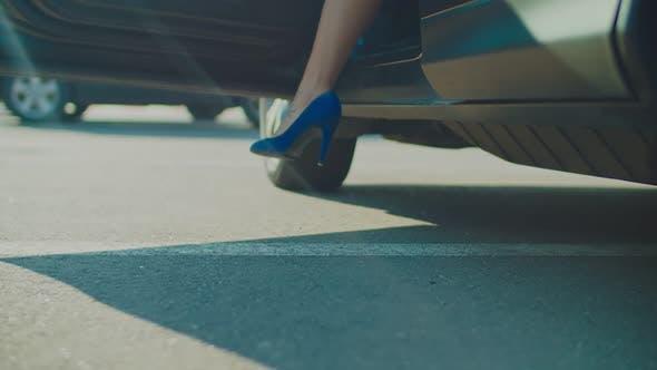 Slim Female Legs in High Heels Getting Out of Car