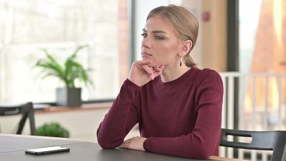 Thumbnail for Pensive Young Woman Thinking in Office, Thoughts