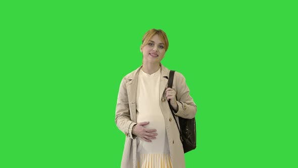 Thumbnail for Happy Pregnant Girl Student Walking on a Green Screen, Chroma Key.