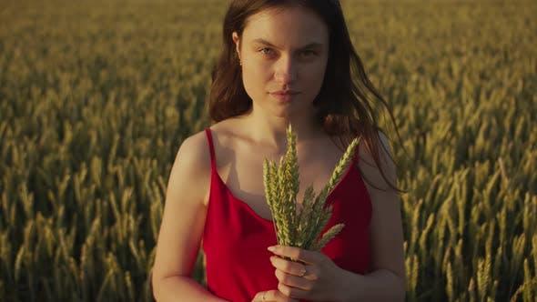 Beautiful Girl Holding Wheat Ears in Her Hand