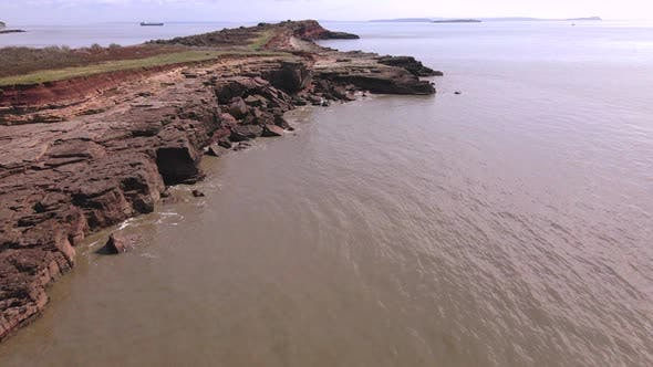 Thumbnail for A Low Shot over a Craggy Beach on an Island