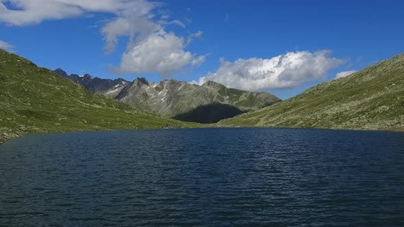 Timelapse view on peak of mountains and lake in Swiss Alps