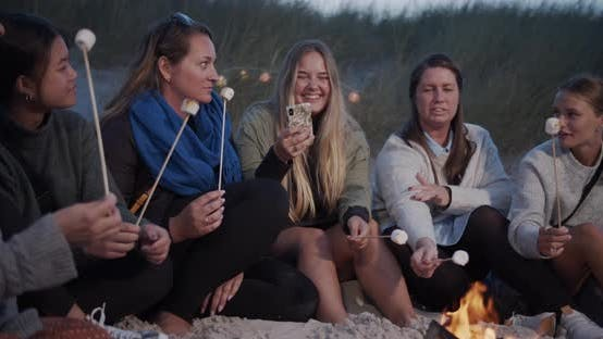 Thumbnail for Friends Sitting By the Sand with Campfire and Smores