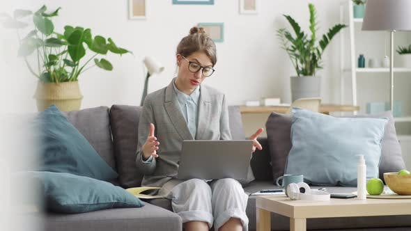 Thumbnail for Business Lady Web Conferencing on Laptop while Working Remotely from Home
