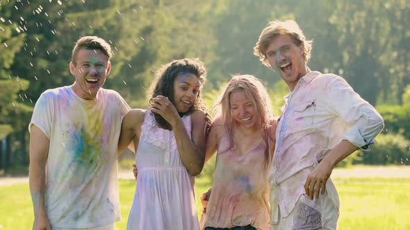 Thumbnail for Amused Couples Celebrating Summer Open-Air Color Festival, Extra-Slow Motion