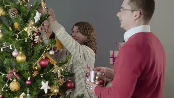 Thumbnail for Happy Family Decorating Christmas Tree, Preparing for Holiday, Festive Mood
