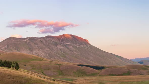 PAN: sunset over blooming cultivated fields, famous colourful flowering plain in the Apennines, Cast