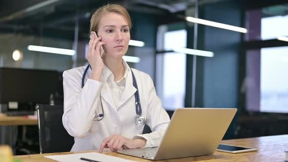 Thumbnail for Hardworking Young Female Doctor Talking on Smartphone in Office