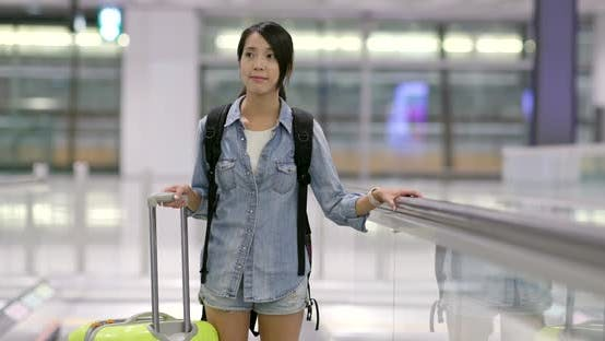 Thumbnail for Woman go travel and carry with luggage in the airport