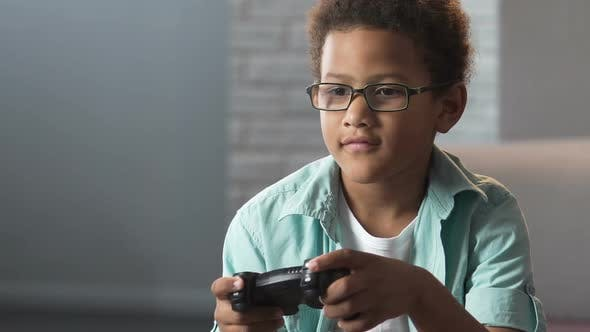 Cover Image for Mixed-Race Boy Playing Video Games, Play Station Addiction, Inactive Hobby