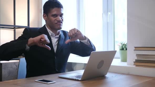 Thumbnail for Thumbs Down by Black Businessman while Working on Laptop