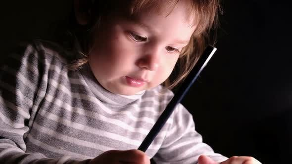 Thumbnail for Little Girl Child Learns To Draw with a Pencil on Paper, Slow Motion