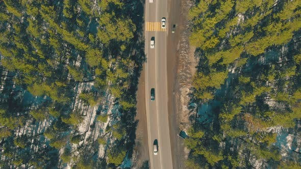 Thumbnail for Flycam Moves Above Fast Vehicles Driving Along Roadway