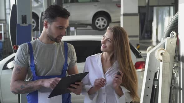 Thumbnail for Mechanic and Customer or Car Owner Signing Pape