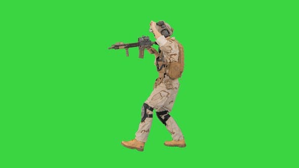 Thumbnail for Soldier Walking Aiming with Rifle and Using Radio on a Green Screen, Chroma Key