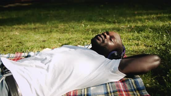 Thumbnail for Afro-american Man Enjoying Music in Park
