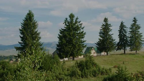 View from the window on the village with houses on the background of fields