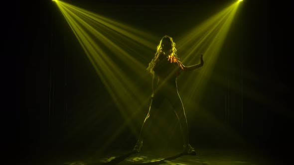 A Fashionable Jazz Funk Dance Performed By a Young Girl in the Rays of Colored Strobing Spotlights