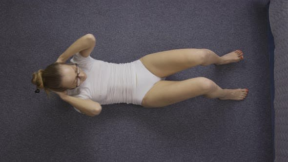 Thumbnail for Sporty Woman Doing Crunches on the Floor at Home