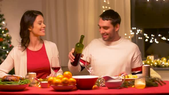 Thumbnail for Happy Couple Drinking Red Wine at Christmas Dinner 10