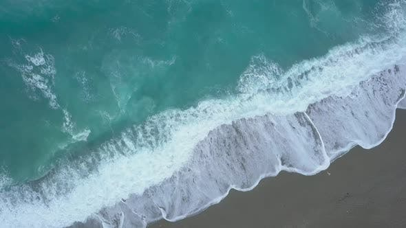 Thumbnail for Aerial Top Down Turquoise Sea Waves Foaming and Splashing Reaching Shore From Above Empty Beach