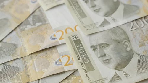 Serbian 2000 dinar paper denominations slow tilt 4K 2160p 30fps UltraHD footage - National banknotes