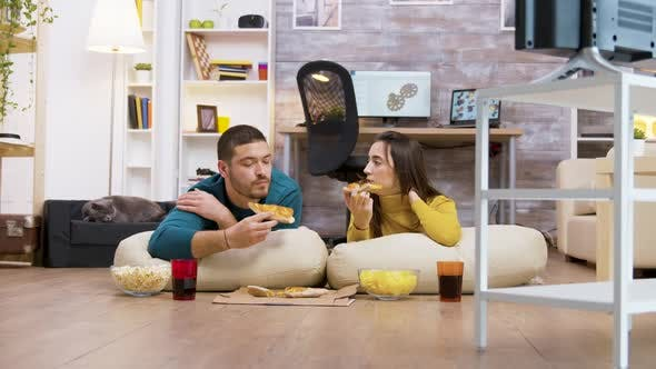 Thumbnail for Zoom in Shot of Young Couple Sitting on Pillows